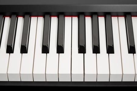 a grand piano: grand piano ebony and ivory keys, closeup view Stock Photo