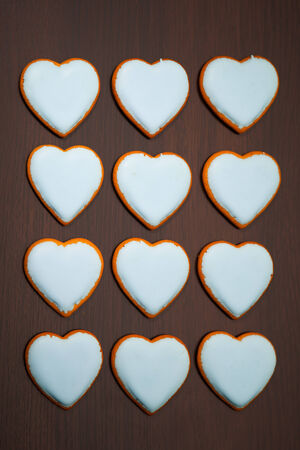 multitude: multitude of cookies hearts on brown background Stock Photo