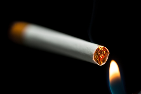 lighting up a cigarette black background photo & Lighting Up A Cigarette Black Background Stock Photo Picture And ... azcodes.com