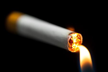 lightup: lighting up a cigarette, black background
