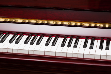 ebony and ivory keys of red piano photo