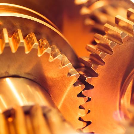 cog wheels: golden gear wheels, close-up Stock Photo