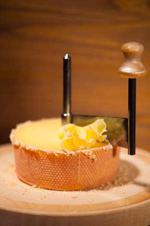 girolle: swiss cheese with girolle knife  Stock Photo