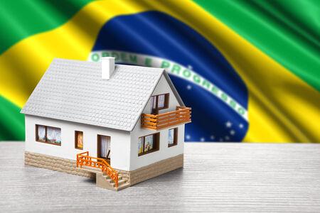 flag background: classic house against Brazilian flag background Stock Photo