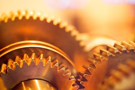 golden gear wheels, close-up Stock Photo