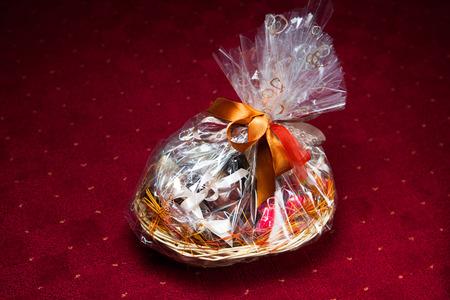 hamper: gift basket against red