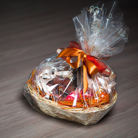 gift basket against wooden  photo
