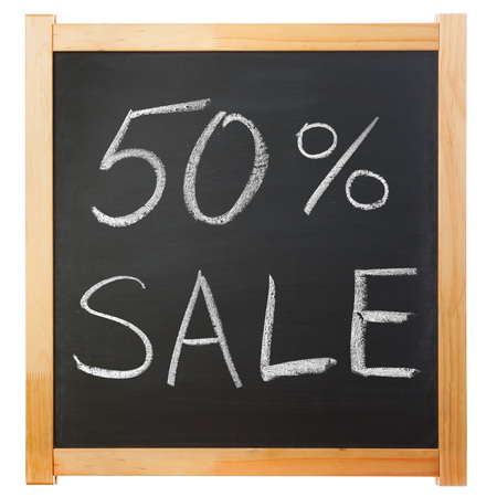 write off: 50-percent sale title written with a chalk on the blackboard Stock Photo
