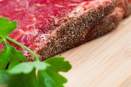 hardboard: fresh marbled meat on a wooden hardboard