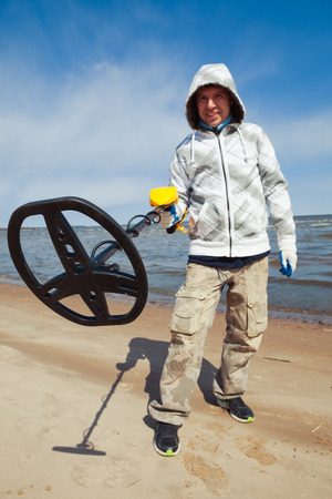 metal detector: man using a metal detector