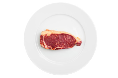 one piece: fresh marbled meat on a plate, isolated on white Stock Photo