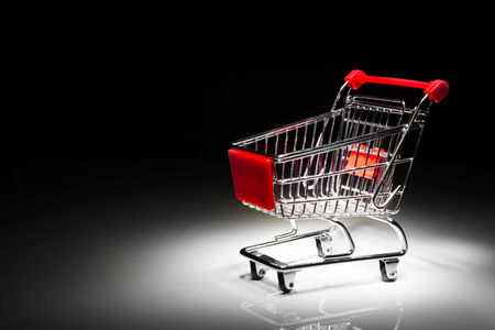 shopping cart: shopping cart on black background with copy-space Stock Photo