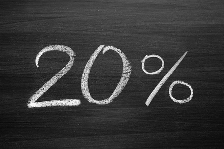 20-percent header written with a chalk on the blackboard photo