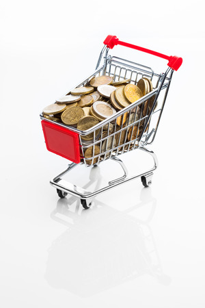 shopping cart full of money on white background photo