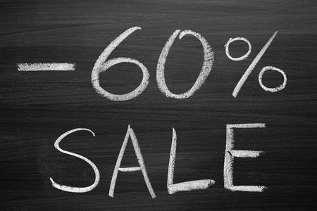 write off: 60-percent sale title written with a chalk on the blackboard
