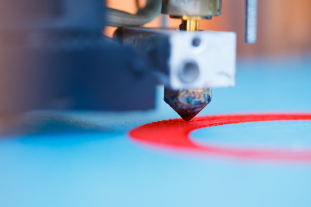 head of 3d printer in action Stock Photo