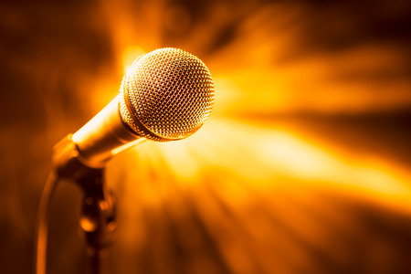 volume glow light: golden microphone on stage