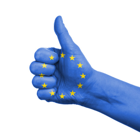 European union concept - hand thumbs up with eu flag photo