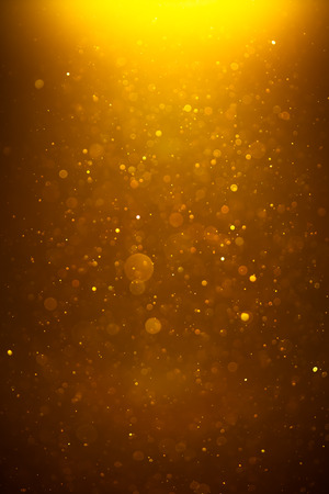 背景の金色の光沢のあるボケ味