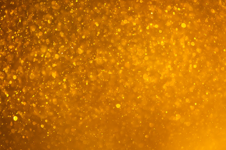 golden light: abstract golden background with particles Stock Photo