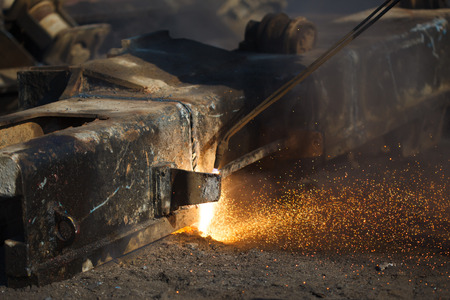 scrap metal cutting with gas welder photo