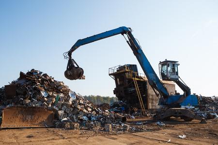 scrap heap: working metal scrap loading machine