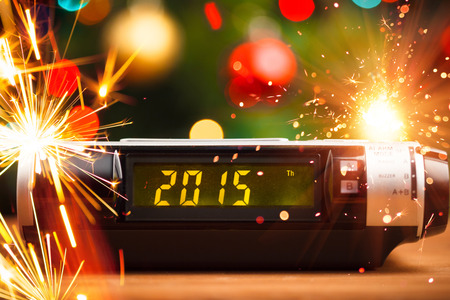 Led display of alarm clock with 2015 new year photo
