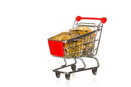 shopping cart full of money, isolated on white photo