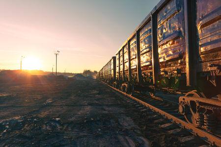 goods train: freight train goods wagons at sunrise Stock Photo