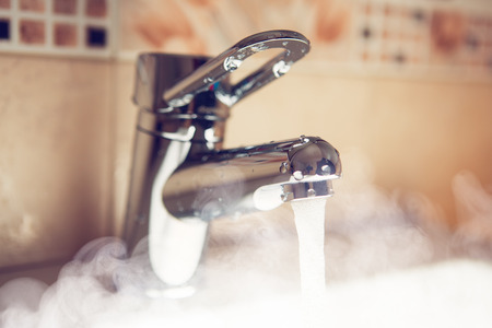 water tap with hot water steam