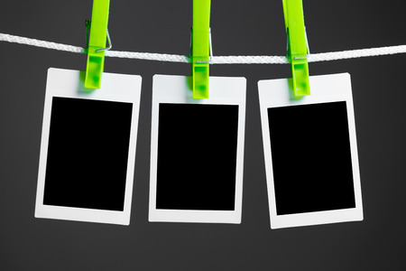 advertising space: blank photos hanging on rope, blue