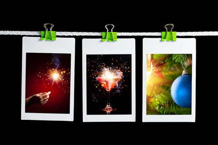 christmas pictures hanging on rope, black background photo