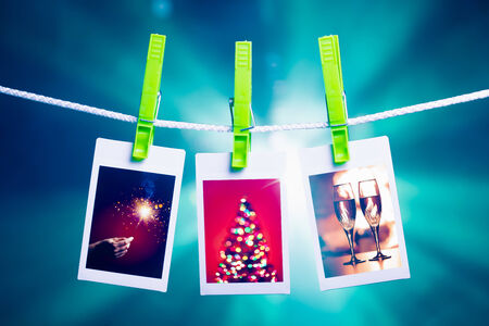 christmas pictures hanging on rope, blue lights background photo