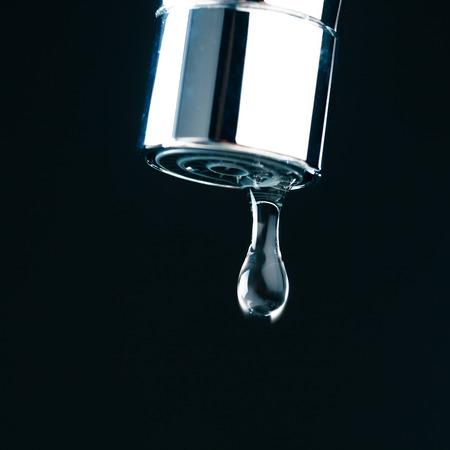 watertap: water drop on faucet, macro view Stock Photo