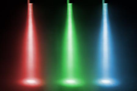 ステージ上の 3 つのカラー スポット ライト 写真素材