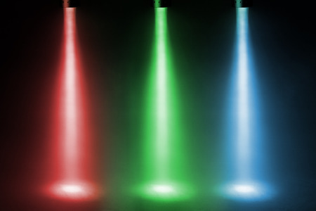 defuse: three color spotlights on stage