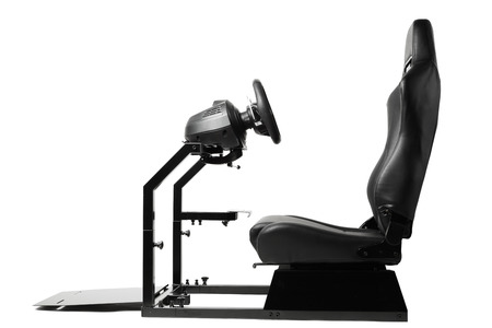 racing simulator cockpit with seat and wheel, isolated on white photo