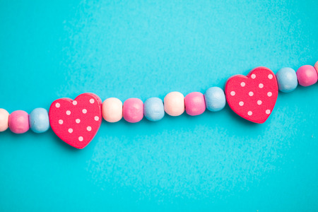 toy heart shapes on blue background 写真素材
