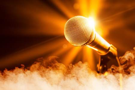microphone: golden microphone on stage with smoke Stock Photo