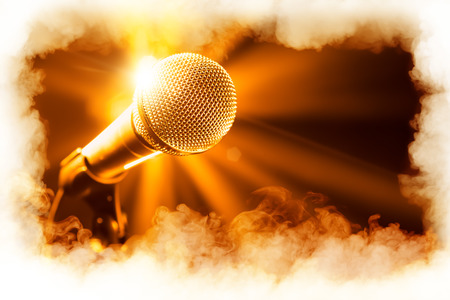 volume glow light: golden microphone on stage with smoke frame