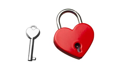 door lock love: heart shaped closed lock with key, isolated on white Stock Photo