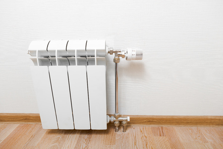 radiator: radiador de calefacción en el hogar