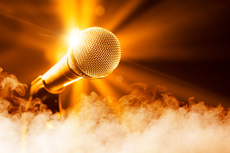 microphone stand: golden microphone on stage with smoke Stock Photo