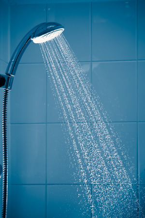 contrast shower with flowing water 写真素材