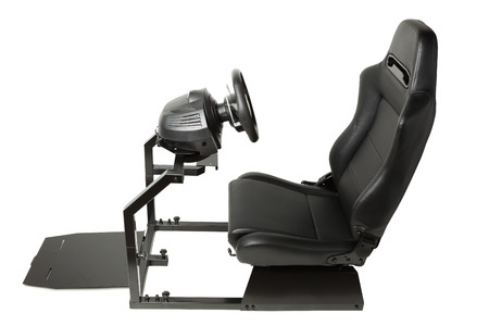 simulator: racing simulator cockpit with seat and wheel, isolated on white
