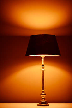 lamp light: interior lamp with warm light against plaster wall background Stock Photo