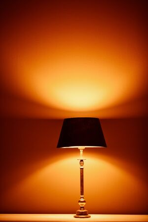 wall light: interior lamp with warm light against plaster wall background Stock Photo