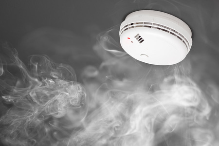 abstract smoke: smoke detector of fire alarm in action