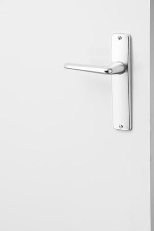 door handle: metallic door handle, white background Stock Photo