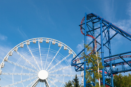 theme park: ferris wheel and roller-coaster in theme park